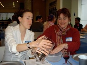 Rebecca Levinn and Sharon Groves washing hands as part of the Seder ritual