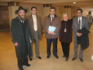 Rabbi Yeshaya Cohen with his delegation and Washington DCJCC CEO Arna Meyer Mickelson