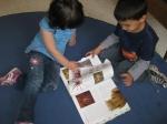 Kofim looking at a bug book
